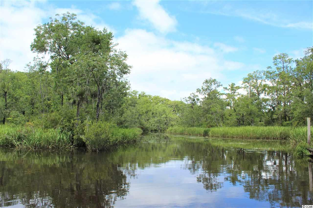 Beautiful almost full acre creek front lot in Pawleys Island. Great location for a dock!