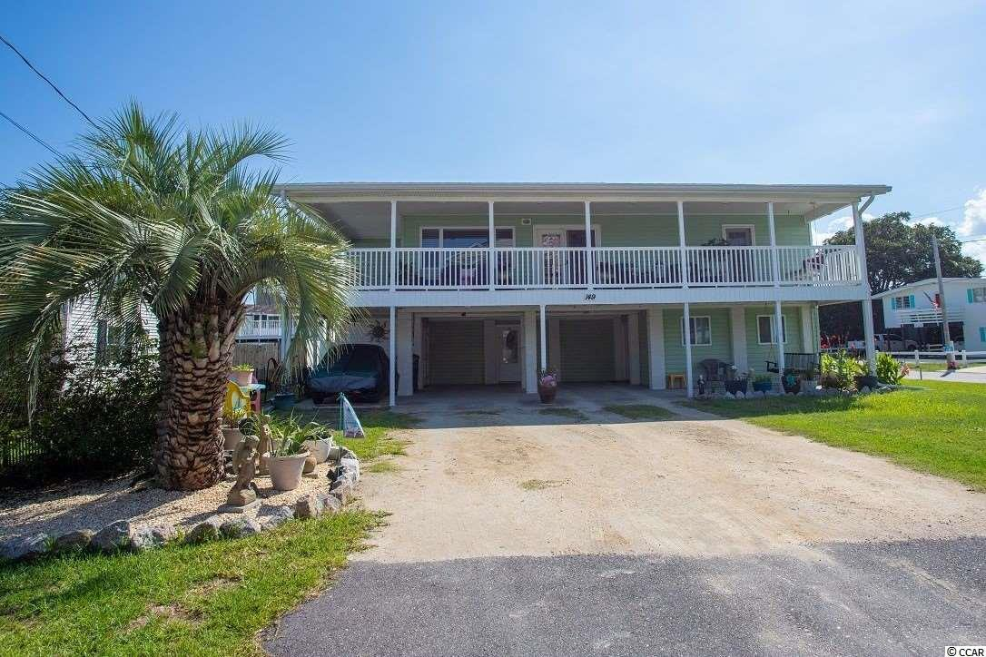 Incredible Opportunity! Must See this updated Beach home located about 200 yards to the Atlantic Ocean. Huge Corner Lot with plentiful Parking and NO HOA!   Feel the Ocean breezes on your Wrap around Front Porch Balcony that spans the entire front of the home. Vinyl Hand-railing for no maintenance painting. Hurricane rated roofing including all upstair windows. Open Floor Plan boasts windows galore, relaxing living area, cozy dining beside the dual french doors leading to your huge outdoor Balcony. Spacious kitchen with work island, upgraded appliances including a large Kohler dual sink overlooking the extensive back yard with glimpses of the sunset over the Marsh. 3 Bedrooms on upper level which includes Master with French Door leading to Front Deck. Full Bath up includes two separate sinks with tiled tub & shower.  Studio/Mother in Law suite on first level with private entrance. Kitchen, Full Bath which could be short term rental or for additional friends and family. Outside attached storage and detached storage shed to store your golf cart and so much more! Rare find will go quickly! East of Business 17 Close to beach, Garden City pier, golfing, Murrells Inlet Marshwalk restaurants and Myrtle Beach entertainment. Square footage is approximate and not guaranteed. Buyer is for responsible for verification.