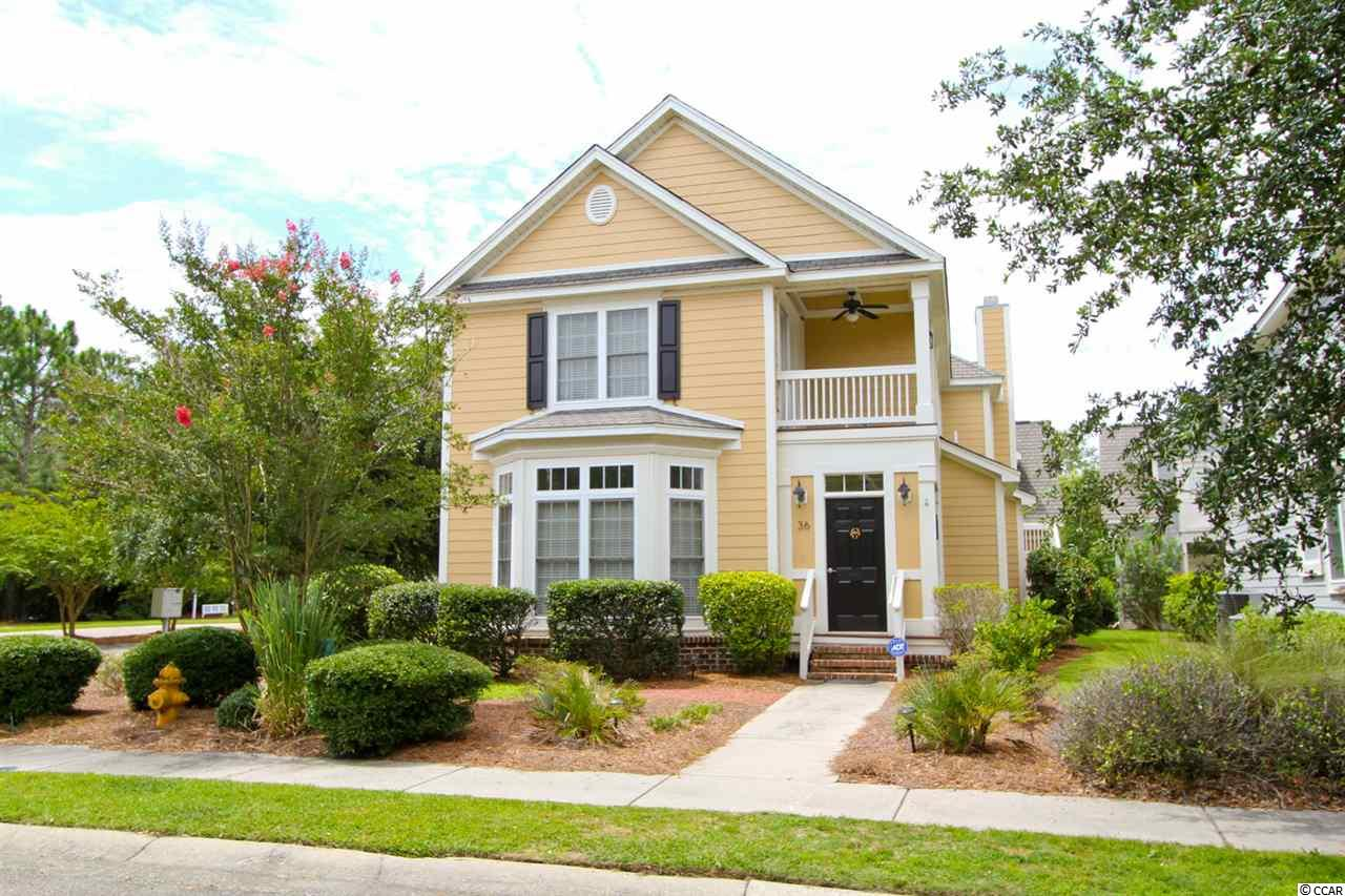 Your dream of beach living awaits in this Charleston style home located on a corner lot in the gated Reunion Hall community.   With ownership you have private access to Litchfield by the Sea Resort and one of the most beautiful seascapes on the Atlantic. This well-kept home features 3 bedrooms all upstairs and 2 1/2 baths in the main house and a separate apartment with its own full bath and kitchenette space above a two car garage. Hardwood floors, tall ceilings and a great flow create generous spaces including a large living room featuring tall bay windows and a 15 x 17 master bedroom with private balcony, tray ceiling, and walk-in closet.  The master bath includes a large soaking tub, separate shower and double vanities. An arched entrance frames the beach inspired dining room with statement beaded chandelier. The dine-in kitchen with granite, stainless and plenty of upgraded cabinets adjoins a comfortable family room with fireplace and double French doors to the deck for indoor-outdoor entertaining. When away it has a security system set up for added convenience.  With walking trails throughout, the beach at LBTS and pool at River Club are only a short bike or golf cart ride away along with convenient shopping, dining, golfing, and tennis options.  Arrange your viewing today!