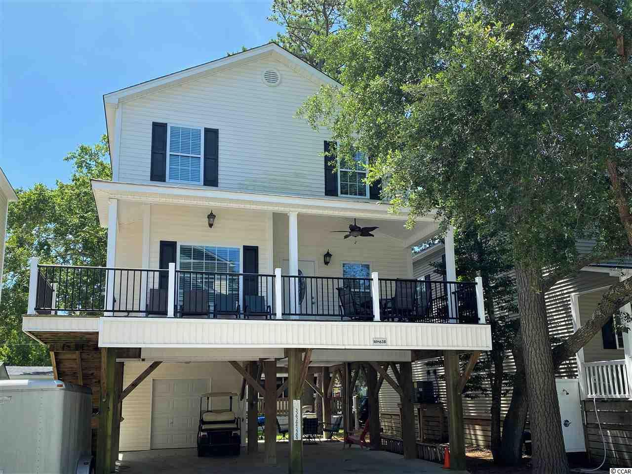 This stunning 4-bedroom, 2-bath home is located in the ocean front community of Ocean Lakes! Perfect for a vacation home or rental!  Move in ready! This beach getaway comes fully furnished, including a complete kitchen set up! Home features a partially covered deck with ceiling fan, outside shower with hot/cold water, outside power & cable for TV, separate HVAC for 1st & 2nd floors, white wood cabinets and granite in the kitchen, ceiling fans in all the bedrooms & family room, and oak stairs. In addition to the private beach access, Ocean Lakes has 310 acres of amenities that include a water park, outdoor and indoor pools, mini golf, and recreation center! 24hr security and trash pickup.