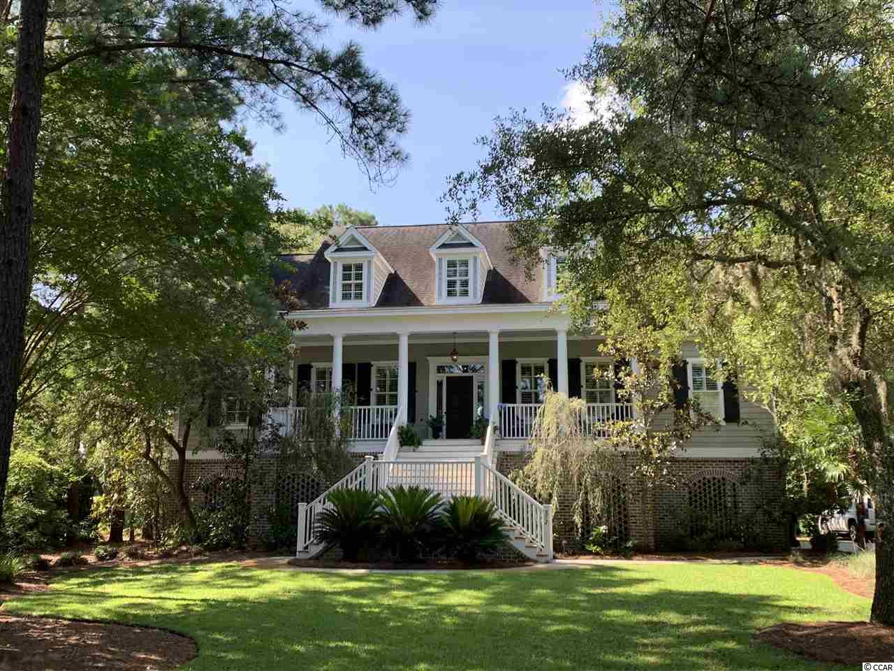 This is a classic Lowcountry home on the golf course in DeBordieu Colony. Located on a quiet street, the both the golf club and beach are a short golf cart ride away.