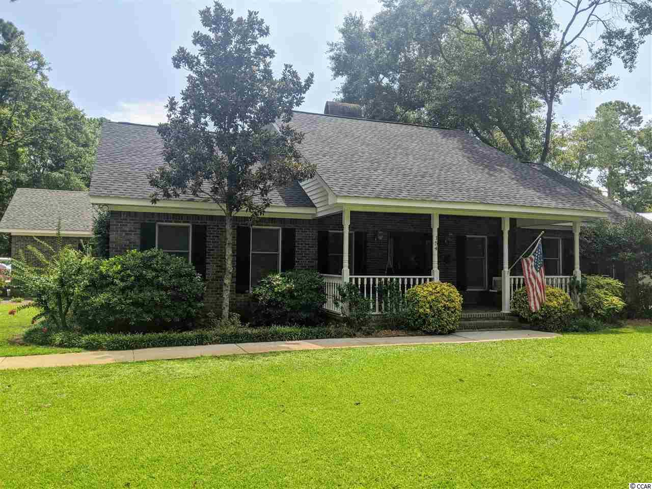This is a truly amazing all brick home located in a voluntary HOA community in Pawleys Island SC. Take a short golf cart ride to locals favorite South Litchfield beach or walk to the local gym. This home is perfectly located in the heart of Pawleys Island. 3 bedroom 3 bath with detached garage on nearly 1 acre with live oak trees and room to grow. This lovely updated home will not last long.
