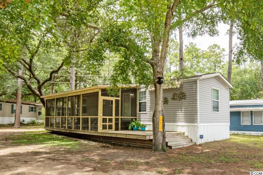 """This custom built modern 2016 home is ready for a new owner.  The sole owners left this home in such pristine condition and only used it as a 2nd get away property a hand full of times each year.  The home over looks canal views, beautiful oak trees and next to green space which is great for entertaining.  It is just a short walk to the Garden City Pier, Beach, Shops and Restaurants.   You will love the 300 square foot screened-in porch that really is an extension to beach home living.  Along with a great 150 square foot sundeck with where you get some sun rays when you want to do some grilling or pull out the awning for some shade.   When you come off the beach, or maybe just need a little cooling off, take a cool shower with your backyard shower.  And next to your outdoor showers you have a place to store kayaks in watercraft/storage corral.   In the home you are going to just love all the light, between the extra window's, open concept, luxury light color vinyl flooring throughout, the kitchen """"Driftwood"""" kitchen cabinetry for a beach-y feel.   There are Stainless ceiling fans in living space and bedrooms.   There is also a storage shed in back, that has also been approved to build larger for golf cart storage shed.  Not to mention the Energy-Star certified package.  And yes this home comes fully furnished."""
