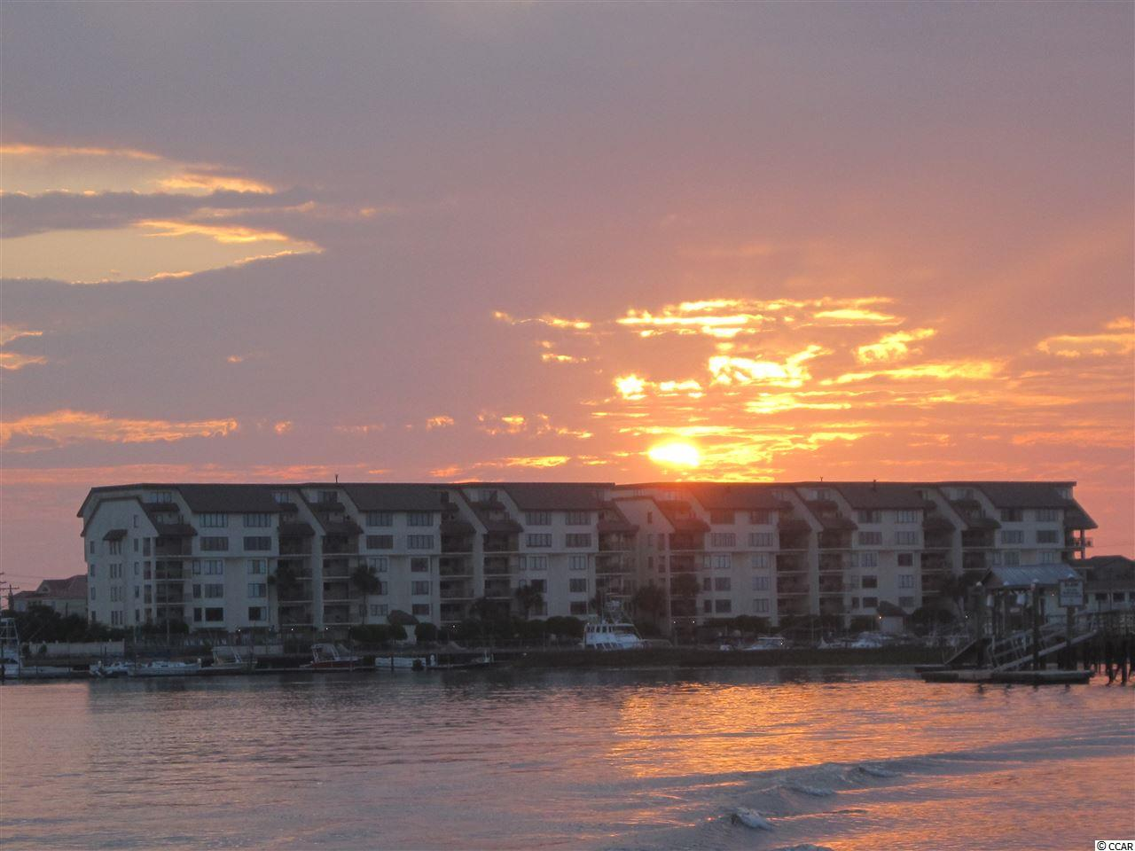 Sunrises and sunsets from your balcony, the best of both worlds! Marlin Quay 201 offers luxury and comfort in a marina setting with pools and an elevator. Enjoy hours of relaxing on the beach, just across the street, or by one of two onsite pools. This two bedroom, two bath condominium has been fully updated, it is a true turn key property. The family room is bright and airy with stylish, yet comfortable furniture with a coastal undertone. The kitchen has all the upgrades including granite countertops and stainless appliances. The bathrooms have also been updated. This inviting beach getaway comes with exterior storage closet, private parking and an assigned parking space. Schedule your private showing soon!
