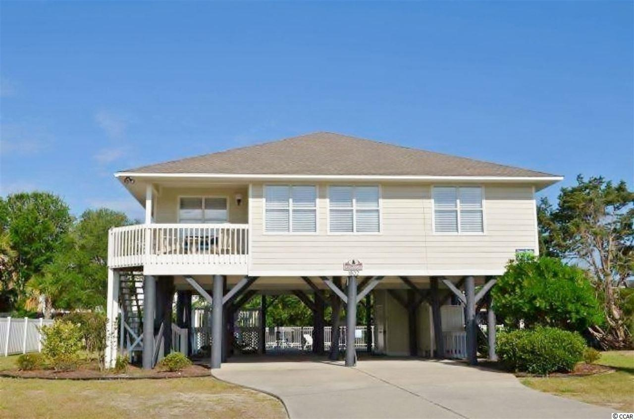 1802 Dolphin Street, known as Windjammer, is located between the beach and the inlet south of the pier in Garden City Beach. The home is four bedrooms, three bathrooms measures 1350 heated square feet, and comes with a private 30x14 saltwater heated pool. The interior is well maintained, making this raised beach house feel like a home. Sold turnkey furnished the home's hub is the living room flanked by the dining area, kitchen and bedrooms/baths. The décor is light, bright and tastefully beachy. The exterior includes parking for at least six cars, covered front porch, two rear sundecks, ground-level storage, and enclosed outside shower. The property is approximately 400 feet to the nearest public beach access and the second row to Murrells Inlet. The peninsula of Garden City has been a sought-after destination for generations offering the small downtown amusement and restaurant district, Garden City Fishing Pier, broad white sandy beaches, Marlin Quay Marina and Gulf Stream Café. The property is a fifteen-minute drive to both the Marsh Walk in the historic fishing village of Murrells Inlet and south of everything the City of Myrtle Beach has to offer. The home is currently on a vacation rental program and producing income that can offset the owner's carrying costs. The rental history is available upon request. Why continue to rent when you can own your very own beach retreat. Make sure to check out the Matterport 3D Virtual Tour. It's like you're walking through the home. Link to the virtual tour: Coming Soon