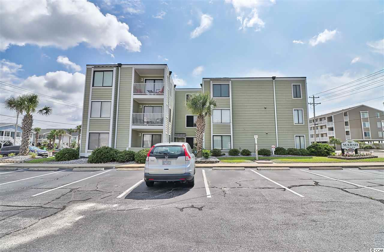 This is a lovely condo in a nice complex.  It is a top floor unit (3rd Floor walkup) with  low rise steps so they are  fairly easy  to climb. Rented heavily this summer - Owners rent themselves. A washer/dryer unit could be added to the owner's closet but the dryer would have to be a vent less dryer. There is an onsite laundry area with washer/dryers that are coin operated.  The unit is being sold furnished.  It is well appointed and nicely decorated. Nicre Views from the front outdoor sitting area.   There is a peak of the ocean from the balcony. Owners can enjoy onsite grill area and enjoy the outdoor pool.