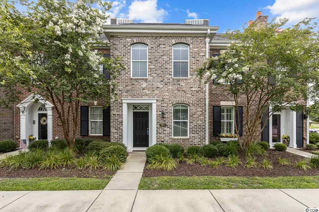 Welcome home to this 2 bedroom, 2.5 bath true townhome in the heart of The Market Common. This location is 1 mile to the beach and is an easy walk to the many boutiques, restaurants, movies, gyms, walking and biking trails.  This all brick townhome is low maintenance living and turn-key ready. Walk through the front door and enjoy looking at tile throughout the foyer, kitchen and living area. The kitchen features stainless steel appliances, granite countertops, white cabinets, and a tasteful backsplash. The half bath, laundry room and storage closet are also downstairs. Off of the living room there is a great outdoor courtyard for entertaining and has been upgraded with pavers throughout! Outdoors, you can sit back and relax on the fully enclosed private backyard/patio area, it's perfect for entertaining. This courtyard leads to the one-car garage that features shelving for extra storage. Upstairs, there are two bedrooms that have ceiling fans and both have their own walk-in closets. They also have their own private baths with granite countertops. One has a double sink and the other has an upgraded beautiful tile shower! The HOA takes care of all exterior landscaping, exterior insurance and maintains the green spaces and park benches right outside the front door.  Owners have the option to purchase a membership to the Market Common Amenity Center which features a resort style pool with a lazy river, 2 hot tubs, hammocks, activities, facilities, and a gym.  This townhome allows for low maintenance living and offers the option to be a great primary residence, second home, or investment opportunity. Come and be a part of this one of a kind community, schedule your showing today!