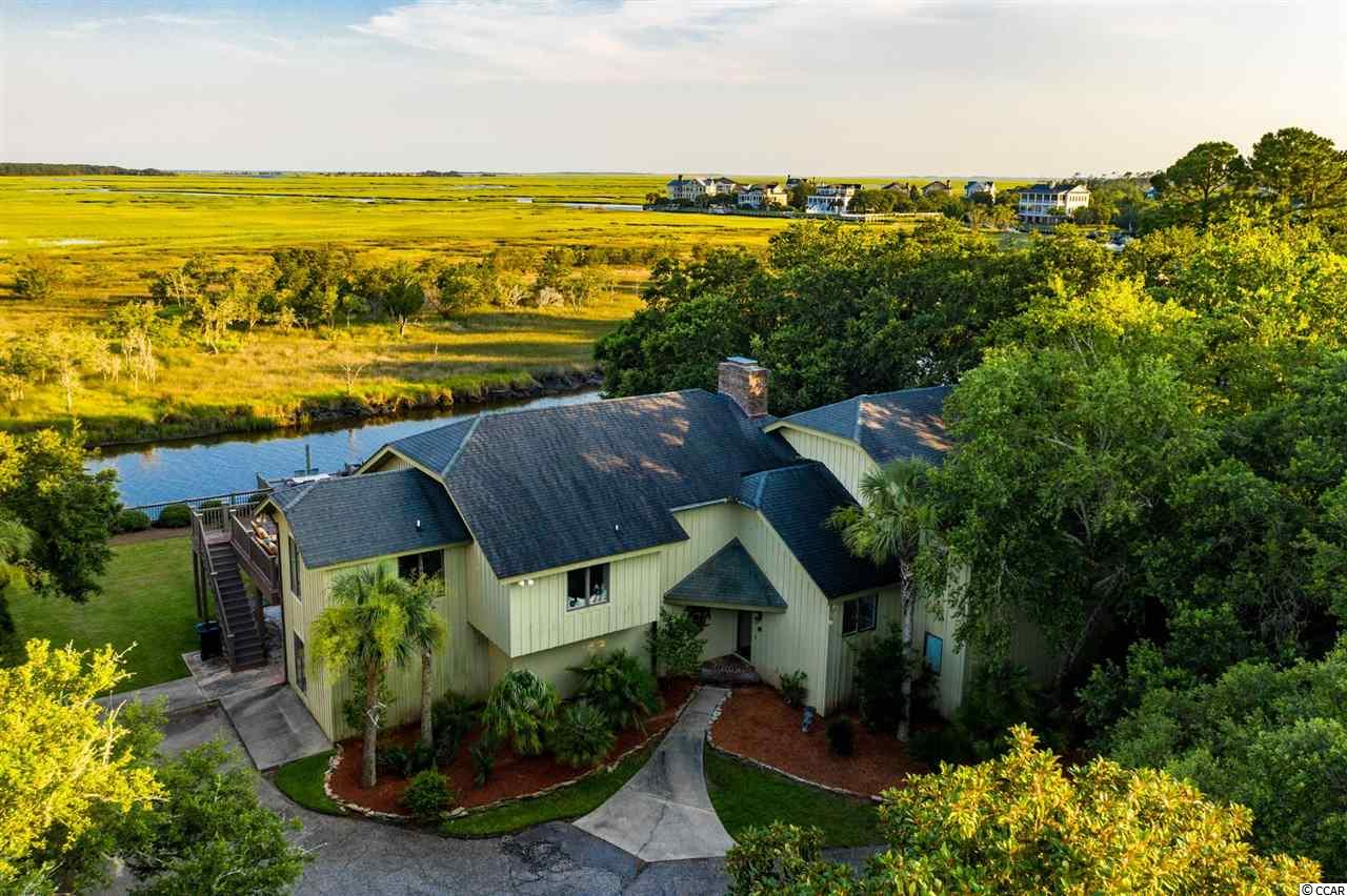 Creek front in Debordieu Colony with expansive views of marsh creeks! This home has been thoughtfully modernized by the current owners. With expansive rooms on the top floor, including great room, kitchen, dining room and morning room overlooking the marsh, you will find a myriad of venues for dining and entertaining. The master suite offers a sitting area and oversized walk in closet, located on the creek side of the house offering beautiful views.  Three bedrooms and en-suite baths are located on the first level as well as a media/theatre room. The dock provides easy access via North Inlet to the Atlantic Ocean and to waterways that lead to Winyah Bay and the Intracoastal.  Embrace this coastal lifestyle that is matchless.  Debordieu Colony, a private 2700 acre community offers miles of beach, championship golf on a course designed by Pete and P.B. Dye, professional tennis, two swimming pools, on-site nature preserve with bike paths and walking trails, as well as fine or casual dining. Drive time from the security gate to the 6000' runway at Georgetown County Airport is approximately 20 minutes.