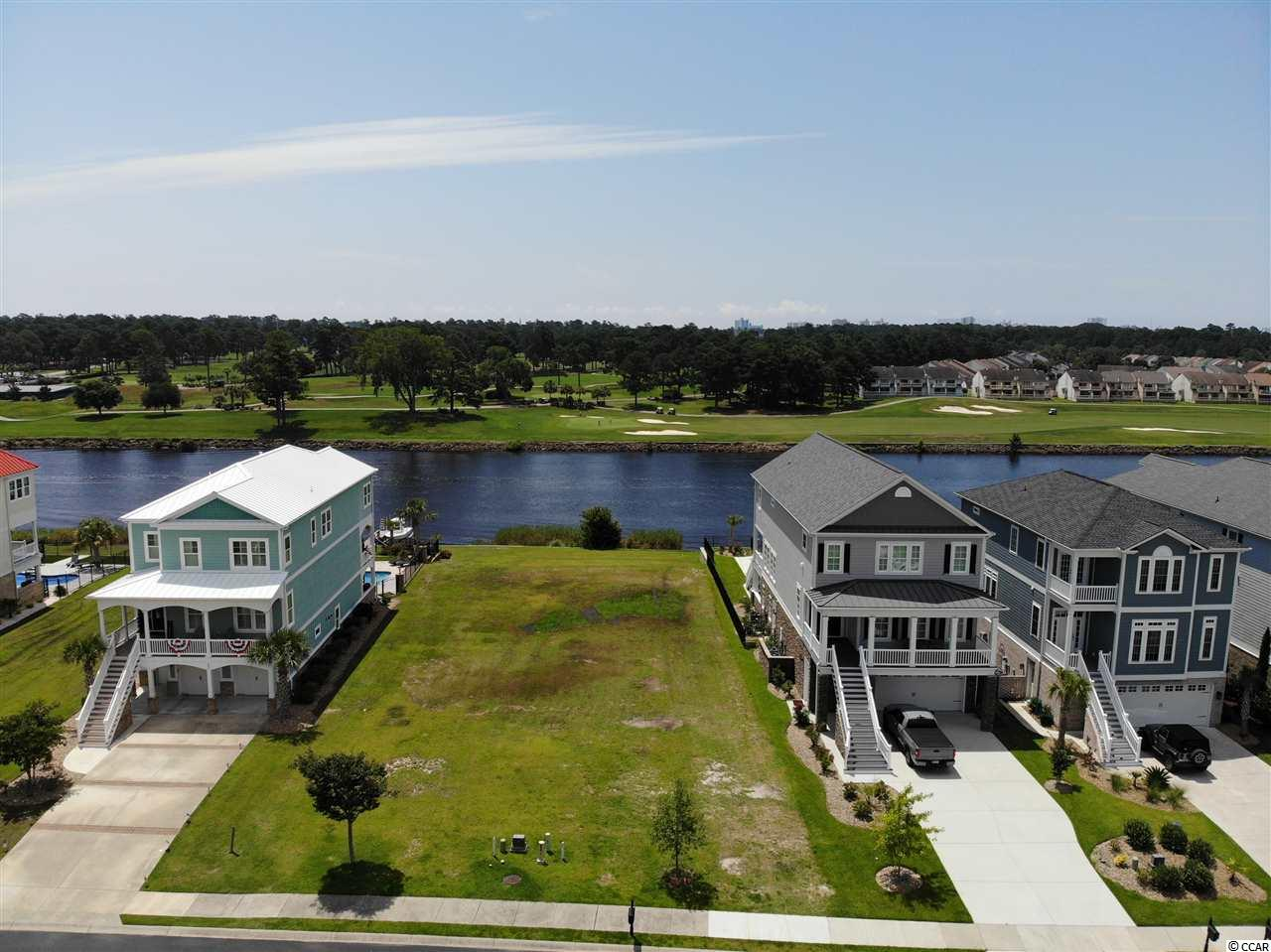 Awesome homesite on the Intracoastal Waterway.  This home site has no homes across the ICW and looks at the green of the Myrtle Wood Golf Course.  Buy now build later, no building timeframe. Waterway Palms Plantation is a gated planned residential community located on the Intercostal Waterway (ICW). Situated in Carolina Forest Waterway Palms is perfectly located near shopping, grocery stores, and other daily goods and service vendors. Only a short 6-mile drive to the wide, friendly beaches, and the Atlantic Ocean Waterway Palms offers the best of both land and sea.