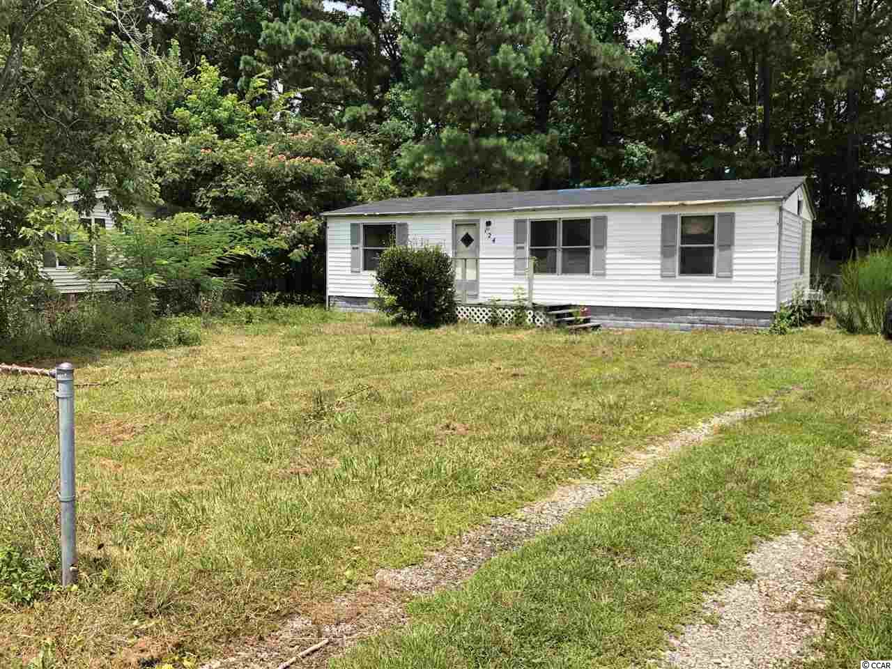 .25 acre lot close to waterway, Market Common and the beach.  Home was badly damaged by fire and price is based on value of lot alone.  There is no access to the home.  Buyer can remove or repair the home at their discretion.