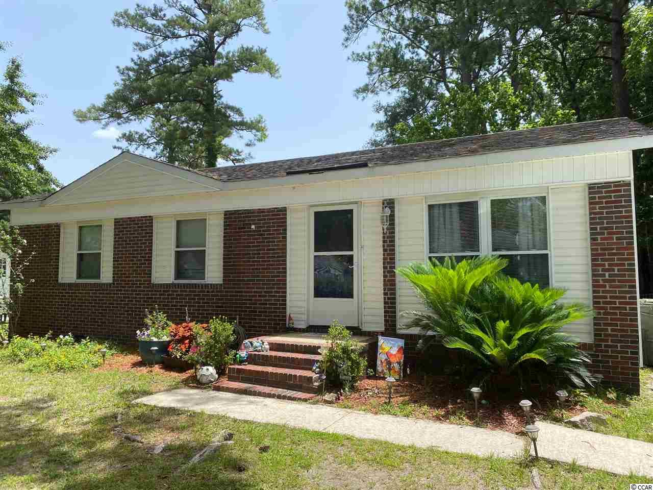 Welcome to this cozy but spacious home with large fenced in back yard. Newly updated kitchen with granite counters and upgraded cabinets. Move in condition with fresh paint and flooring. Master bedroom is spacious and offers a half bath. Home is located close to Winyah bay! Public boat lands are minutes away. You don't want to let this one get away...