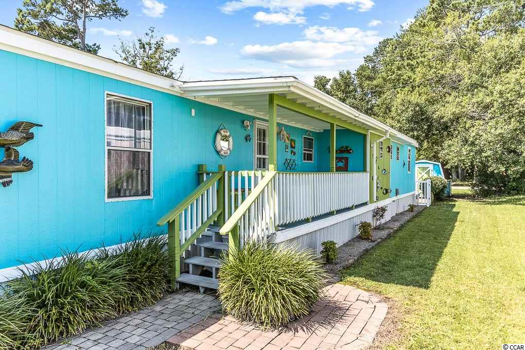 This 4 bedroom, 2 bathroom, manufactured home is the perfect opportunity for your next beach house! With the open floor plan and unique lay out, you have the chance to make it your own. The 4th bedroom can also be used as an extra living space or bonus room which conveniently accesses the fenced in backyard. Captain's Cove is a 55+ community that offers a pool and clubhouse with various recreational activities to choose from. It is also located close to some of the Grand Strand's best highlights including the Marshwalk (5 minutes), Brookgreen Gardens (6 minutes), and Huntington Beach State Park (11 minutes). Do not miss the chance to check this out!