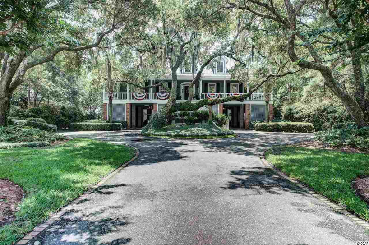 3320 Luvan Boulevard is a quintessential lowcountry creek home on beautiful DeBordieu Creek, providing boat access and expansive creek and marsh views out over the North Inlet estuary system. The main level has a den with a bar that connects to the kitchen. There is also a large family room, office, and guest bedroom. Upstairs is the master suite and two more bedrooms that share a bathroom. There are breathtaking views from the main living room, kitchen area, and porch. The large dock can accommodate your creek fleet. Enjoy an open park and wildlife viewing area across the street. The homesite is lovely, filled with live oaks and manicured grounds. DeBordieu's private Pete & PB Dye Golf course is a brief golf cart ride away. DeBordieu's beach club, tennis and fitness facility are within easy access. Untie from your dock and take a beautiful ride out to North Inlet's pristine beaches for picnicking, fishing or exploring fun.