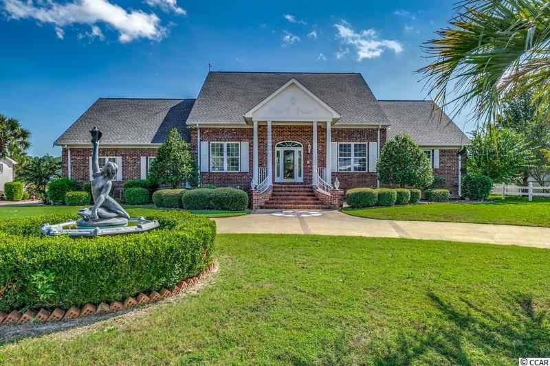 Waterway life in this majestic all  brick 5 bedroom, 3 and a half bath waterway front home in Little River in the prestigious community of Cedar Creek.  This home has 124 ft. on the IntraCoastal  waterway and a private boat dock and lift.  Home features include a spacious living room,  overlooking waterway, with fireplace , build in cabinet, wet bar, surround sound , crown molding, chair rail and custom wood base board.  You will love the large master suite also overlooking waterway with jacuzzi tub shower and bidet.  Upstairs has 3 more bedrooms plus a bonus room over garage , perfect space for an office or media room. You will love watching the yachts go by from our upstairs porch which runs the length of the home. There is plenty of room in the backyard for a pool if you like!  This beautiful, craftsman southern home is waiting for you!  Don't miss out on this amazing home, as homes in this neighborhood do not come on the market often!