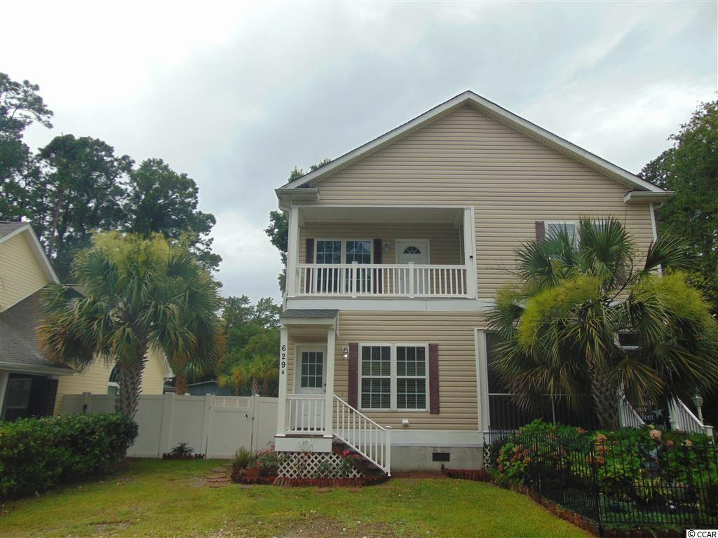 "Very unique townhome style condo, think more duplex in this 3 bedroom, 2 and a half bath unit on the desirable east side of 17 Business in Surfside Beach, known as the ""Family Beach""! Lots of room to spread out, the front room can double as an extra living space and dining, opening to the kitchen. In the back is another living space and a half bath. Follow through to a private fenced in back yard with a great porch. Plenty of room for grilling or a fire pit! Upstairs you will find a great size master bedroom with private balcony and bath. There are 2 additional bedrooms upstairs along with a hall bath and convenient laundry on the second floor as well. The HOA is self managed and includes the building insurance. The interior was freshly painted and ready to move in! Only a few blocks to the ocean, Surfside residents can take their golf cart to the beach and park for free! Ideal location, don't let this one get away! Square footage is approximate and not guaranteed. Buyer is responsible for verification."