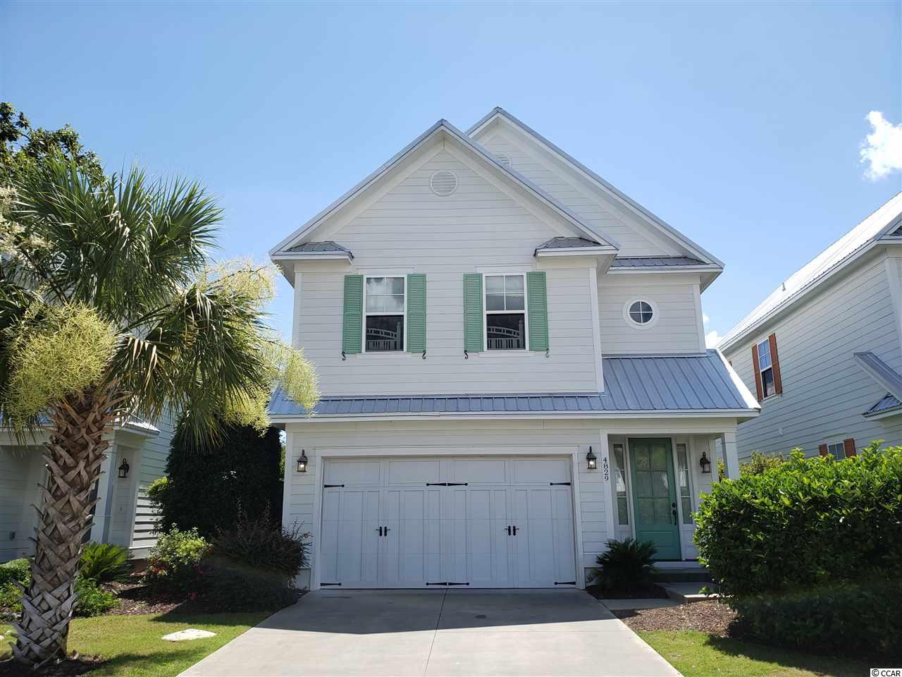 Beautiful 3-bedroom, 3.5-bath furnished home w/2-car garage in the North Beach Plantation community. Enjoy the cozy back patio or take a 5-minute stroll to the 2.5-acre oceanfront pool complex that includes 8 pools, 3 hot tubs, swim-up bar, kids area, adults-only area, lazy river & private cabanas. The fitness center, spa & award-winning 21 Main restaurant are also a 5-minute walk away. Free shuttle service takes you anywhere in the community. Low-maintenance home has durable metal roof & fiber cement siding. HOA does all landscaping & lawn care & maintains lawn irrigation system. Walking-distance to Duplin Winery & the 60+ shops and 15+ restaurants at Barefoot Landing. Closer yet are McDonald's, Cracker Barrel, Olive Garden, Longhorn & the popular Joe's Bar & Grill. Its's a short drive to all the fun on Main Street in North Myrtle Beach and to all that Myrtle Beach has to offer. Just 15 minutes to the Little River waterfront & gambling boats. Four golf courses in Barefoot Resort & 100 more nearby. Very strong rental income.