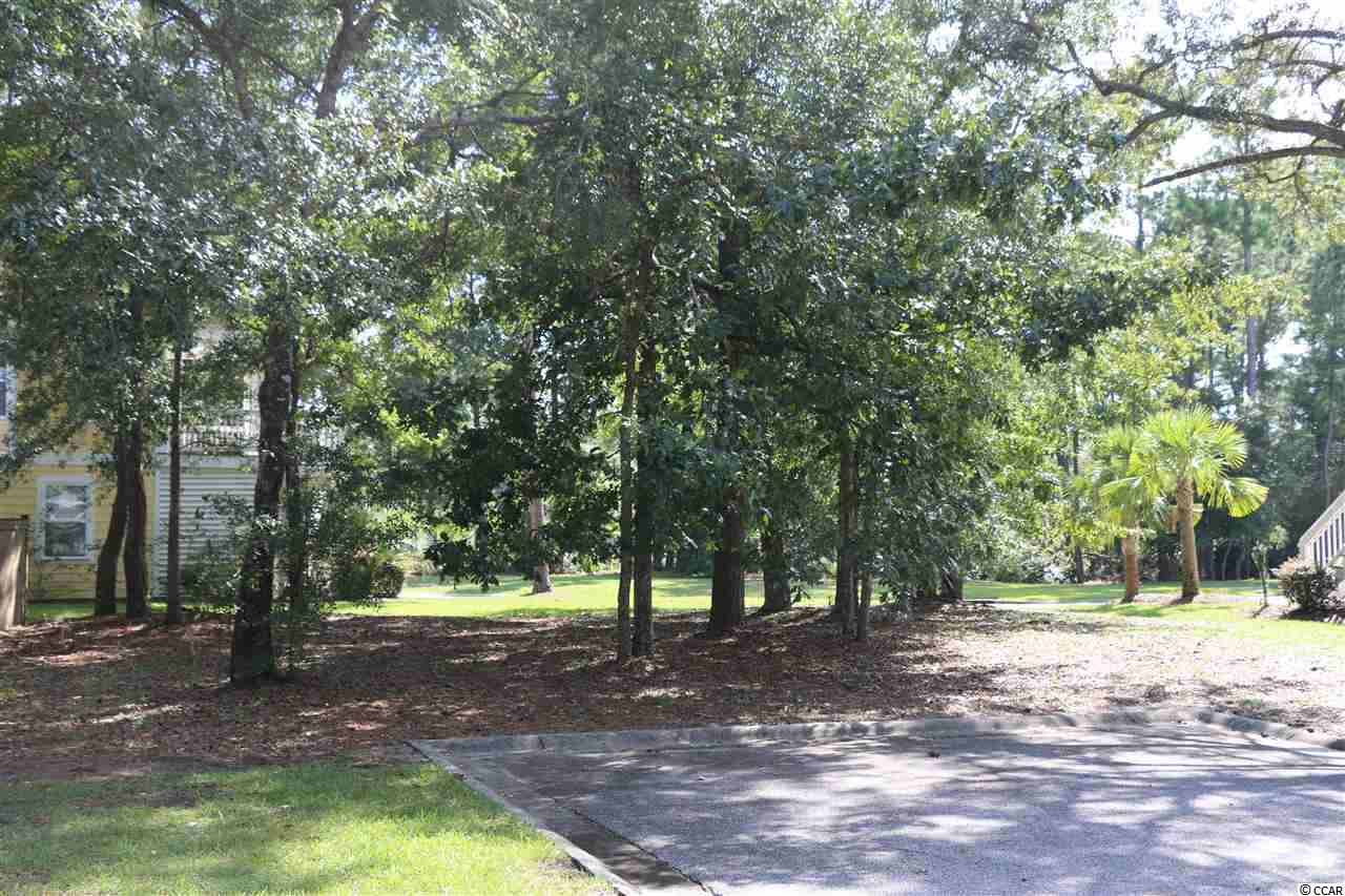 Build your  dream home! Perfect location for permanent home or vacation home! Only a total of 55 lots in the neighborhood. Located at the end of a tree-lined cul-de-sac in the gated community of The Bays at Litchfield, this homesite is within a mile of the ocean. The Bays at Litchfield features a 4-acre pond, clubhouse, pool,  nature trail, and it is wonderfully close to Pawleys Island shopping, golf, and restaurants. Lawn maintenance is taken care of by the homeowners association - so no need to worry, spend more time at the beach or shopping! Remember, when buying or selling a home, Relax we'll take it from here!®