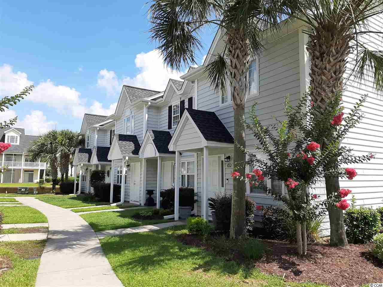 Welcome to Villas @ International Club in Murrells Inlet. A gated resort like community perfect for full time residency or a second home /golf retreat. This 2BR/2.5Ba townhome was recently renovated with New Paint and Carpets throughout. All New Stainless Steel Appliances and New Granite Counter tops in kitchen and bathrooms.  The first floor offers a spacious living room area, dining, kitchen, half bath and a walk in storage area beneath the staircase. Upstairs are 2 bedrooms, each with private baths and walk in closets. The Laundry is also located upstairs adjacent to the bedrooms. Just off the kitchen is a patio area that includes an attached outdoor storage closet and PVC privacy fencing. Villas at the International Club borders the International Club Golf Course, is gated and has a private pool area for residents and guest. The community is conveniently located close to the Murrells Inlet Marsh Walk, Huntington Beach State Park and Brookgreen Gardens. Don't miss it !! Call today with any questions or to schedule a time to view this exceptional home.