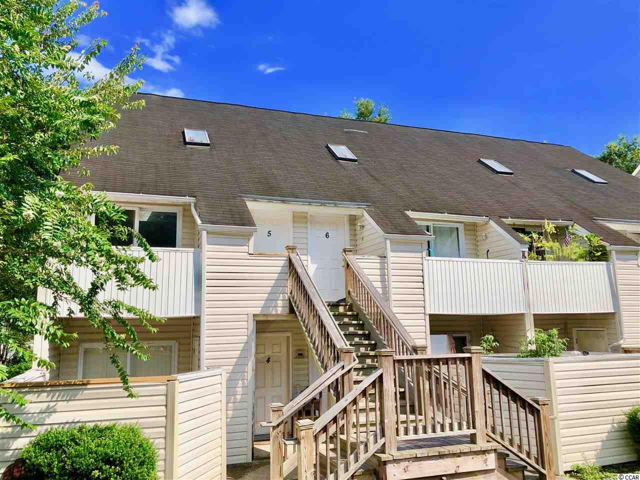 What a great opportunity! Located in the heart of Garden City, this end unit condo is just a golf cart ride away from the beach. Featuring 2 bedrooms and 2 baths, this townhouse styled home will easily accommodate year-round living! There is a size-able living room which opens up to the kitchen and comes with plenty of natural light from the skylight above. The master bedroom on the first floor features a large walk-in closet, master bathroom, and its own private balcony. There is also a separate balcony off of the living area which offers outside storage and is perfect for your morning coffee. Upstairs, there is a spacious, loft styled bedroom which also features a walk-in closet and bathroom. The HVAC Heat Pump was replaced in April 2019, ceilings and walls were recently repainted, and the carpet in upstairs bedroom is new. Washer and dryer are also included. This is a great investment opportunity. Very rarely is there a vacancy in Cambridge Place so the rental potential is good. Located just south of Myrtle Beach and Surfside Beach, Garden City is a small beach community known for its friendly atmosphere, water sports, fishing, and crabbing. The Garden City Pier is extremely popular and is consistently praised for its live entertainment. Don't miss out on this opportunity! Schedule a showing today!