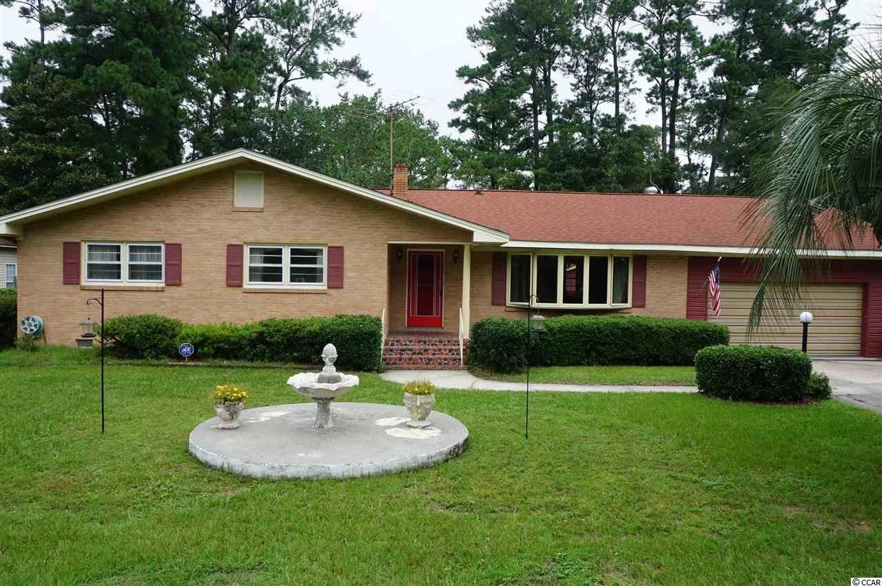 3 bedroom/2 bathroom, ranch style home just south of Downtown Georgetown in Maryville Farms.  All brick home with large fenced in back yard with detached storage room and recently added ceramic outdoor tile walkway and 19 x 23 brick paver patio (also a built-in grill and brick fire pit).  Large formal living room with hardwood flooring and bay window with bench.  Functional kitchen with new oven, tile counter tops, wooden cabinets, and ceiling fan with lights.  Formal dining room off of kitchen for convenience for holidays or dinner parties.  Large sun room off of the great room overlooking the back yard (glass or screen option).  Other features to include, ceiling fans with lights in all 3 bedrooms, kitchen, great room, and sun room; new carpet in bedrooms, hallway, and great room; new interior paint throughout, new PEX plumbing throughout, and outdoor shower. Home is move in ready and is convenient to area shopping and restaurants.  Just minutes from The Harbor Walk downtown and 60 minutes to downtown Charleston.