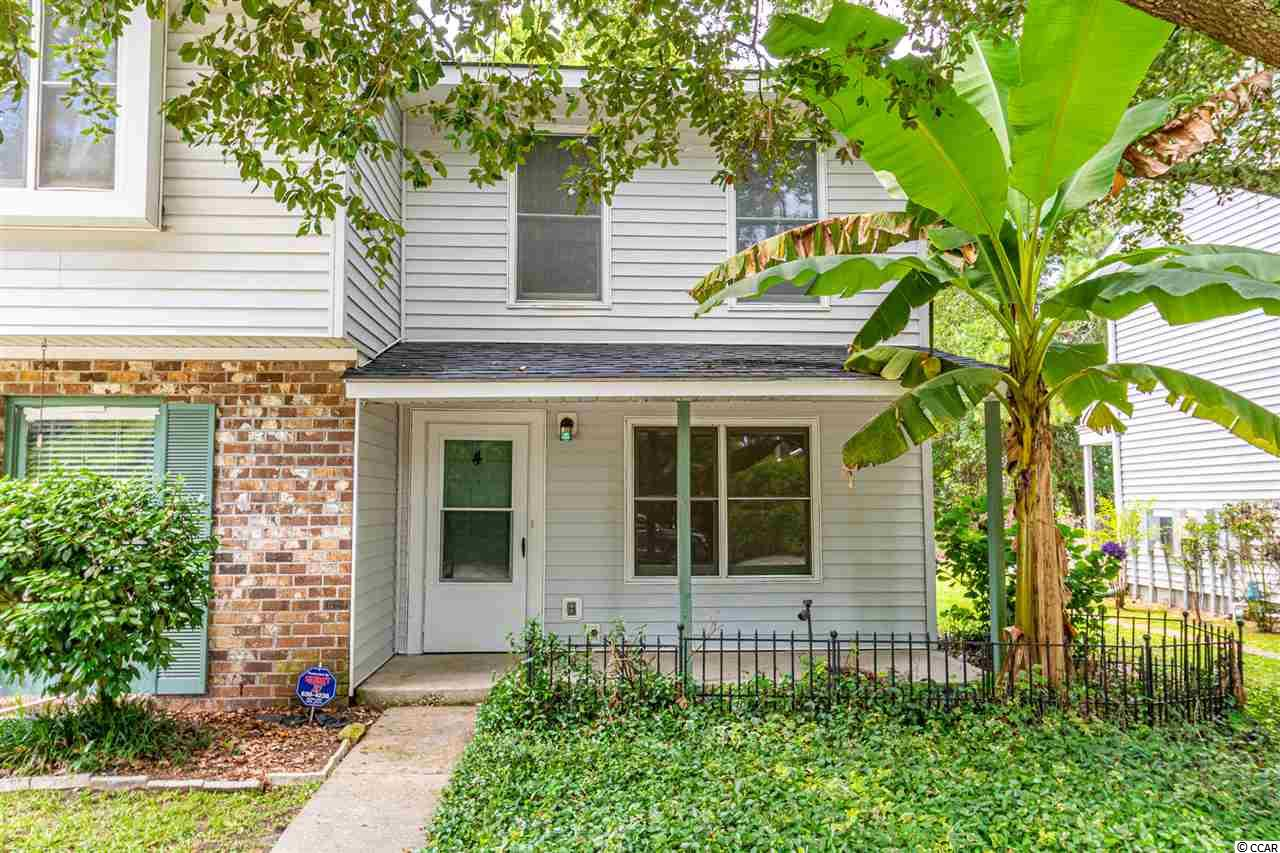 This hidden gem is nestled creekside, east of Highway 17 in Murrells Inlet but close to all the inlet has to offer. With fresh paint and carpet, this end unit townhome is like no other and is move in ready. Relax on the front porch or grill out and enjoy the fenced end patio area. It offers 2 bedrooms and bath upstairs with a half bath downstairs. Close to dining, shopping, the Marshwalk, medical offices and the beach!