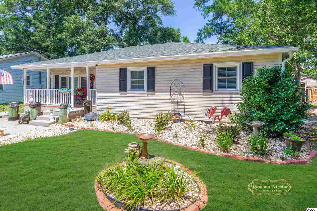 """""""EAST OF 17 IN SURFSIDE BEACH A GOLF CART RIDE TO THE BEACH"""" Just what you want... Darling 3br/2bth home in excellent condition. Fenced in back yard. 16x10 storage building. Outside shower with hot and  cold water.. Owner has added so many special touches...a must see. Won't last...better hurry."""
