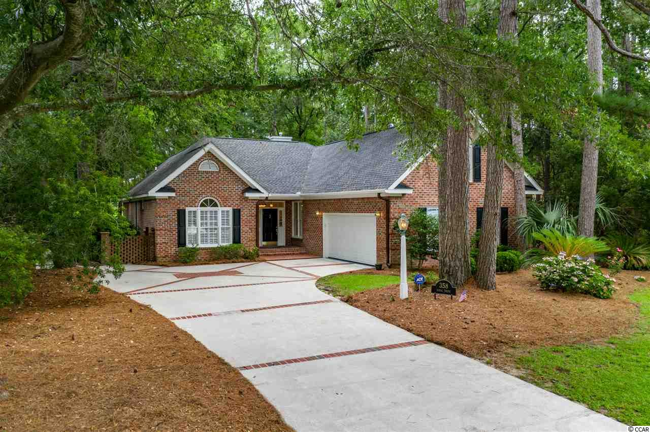 Well-Designed ~ All Brick ~ 3 Bedroom ~ 2.5 Bath Home with Bonus Room ~ Situated on a Beautifully Landscaped Estate Lot overlooking the Heritage Plantation Golf Course in the Picturesque Heritage Plantation Community! Nestled amongst Beautiful Shade Trees and tucked back on a Quiet Street, the location is within walking distance to the Community Pool, HarTru Clay Tennis Courts, Fitness Center, Playground and an Impressive Owner's Club House ~ as well as a Quick Golf Cart or Bike Ride to the Marina on the Waccamaw River with direct connection to the Intracoastal Waterway. The home boasts of a BRAND NEW ROOF (June 2020), New Carpet added to the Bonus Room along with a Freshly Painted Interior to enhance the Flowing, Open Floor Plan with Hardwood Flooring and Tiled Baths. The Flowing, Open Floor Plan is perfect for entertaining with a Large Kitchen that provides Stainless Steel Appliances, Corian Countertops, Custom Cabinetry, Pantry, Breakfast Nook and Work Island. The adjacent 13'x14' Formal Dining Room is enhanced with convenient Build-Ins. The generous sized 18'x18' Living Room offers a Vaulted Ceiling with Skylights and a Gas Log Fireplace. The 24'x11' Room off the Kitchen serves well as a Family Room alongside the 24'x15' Carolina Room with an abundance of Casement Windows providing views of the Fully Fenced Backyard, Spacious Brick Patio, Private Green Space and the Heritage Golf Course.  The Master Bedroom Suite is located on the Main Floor and offers a Spacious Walk-In Closet, Garden Tub, Separate Shower and Dual Vanities. The 2 Guest Bedrooms are located towards the front of the home and they are separated by the Guest Bath. Additionally, the Bonus Room with Half Bath serves well as a 4th Bedroom or other purposes. Beautiful Plantation Shutters embellish every window with the exception of the Carolina Room. The 2 Car Oversized Garage has a work bench, a wall of cabinets and additional storage. The Heritage Golf Club has been Nationally recognized as an Exceptional Course and named #7 Best Course You Can Play in SC by GolfWeek. The Clubhouse offers a Pro-Shop, Restaurant and Bar. The Community's location provides easy access to some of the very best that the area has to offer including an Abundance of Incredible Restaurants, Unique Shops and a Large Selection of Water/Leisure Activities ~ as well as Miles of Gorgeous Ocean Beach to Explore and Enjoy!