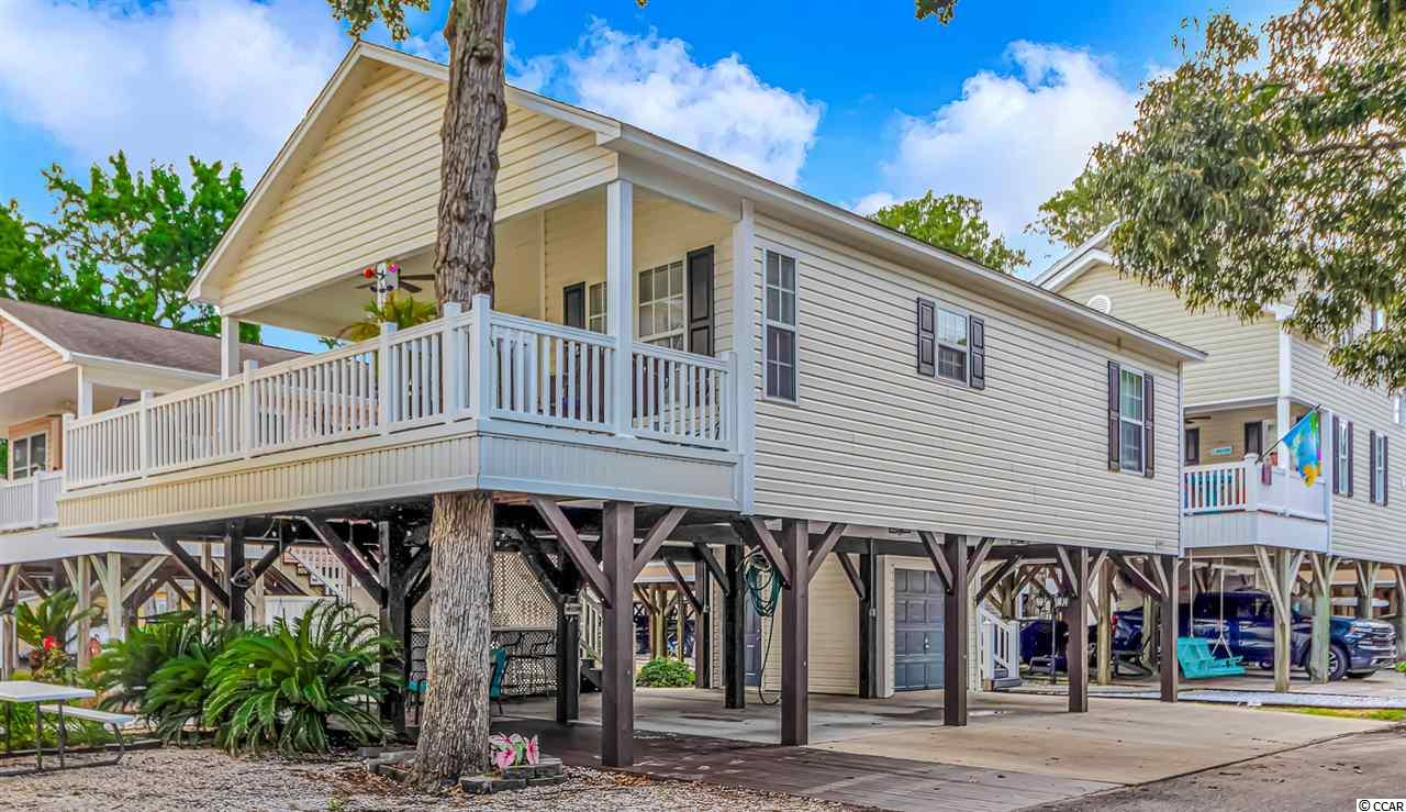 Do you want to live on VACATION full time or have a fabulous rental investment. This raised beach home is in the award winning Ocean Lakes, and is just a short stroll or golf cart ride to THE BEACH, the private water park, camp store, snack bar, and all the other amazing amenities that Ocean Lakes has to offer. This beach hide away features 2 large bedroom and 2 baths. It also includes a large deck and a covered entertainment area downstairs that still allows plenty of room for parking cars and golf carts. BRAND NEW STAINLESS STEEL APPLIANCES!!!! MAKE YOUR DREAM OF LIVING AT THE BEACH COME TRUE!!!!!