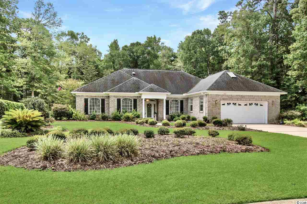 Located in the highly sought-after & gated Pawleys Plantation community, this distinctive all brick 3 bedroom, 2 bath home is situated on over a half acre with peaceful multiple gardens & planters and offers a very unique sense of privacy for its owners who enjoy being immersed in nature. This spacious sunlit home has many of the luxurious features savvy buyers are seeking, such as, decorative quoins, wood laminated, tile & carpet flooring, crown moulding, inviting formal dining room with elegant chair railing, and a comfortable Carolina room with double sliding glass doors that open to the incredible screened-in lanai over the sparkling pool which includes a custom lighting package. The kitchen features breakfast bar, granite counter tops, white on white appliances, a smooth flattop range, side by side refrigerator with ice & water door dispenser, built-in microwave, innovative walk-in pantry, breakfast nook, and cabinets with crown moulding. The exquisite master suite has a stylish tray ceiling, private access to the master bath that features vanity with dual sinks, a jetted garden tub, step-in glass shower, water closet, and practical his & her's walk-in closets. This piece of paradise comes complete with two additional bedroom, full guest bath, over 1,600 sq ft of attic space, a bonus room over the garage, whole house surround speaker system, electronic air filtration system, and a 600 sq ft attached two car garage with work bench & multiple built-in cabinets. This home affords you easy access to the beach and golfing along with all of the other activities and happenings in Myrtle Beach & Murrells Inlet including fun eateries, public fishing piers, Marsh Walk, and intriguing shopping adventures along the Grand Strand. Conveniently located to your everyday needs, including grocery stores, banks, post offices, medical centers, doctors' offices, and pharmacies. Check out our state of the art 3-D Virtual Tour.