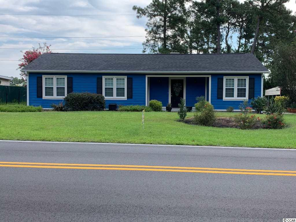 Located between Hwy 17 and the Intra-Coastal Waterway, this property is a rare find offering a large lot with privacy just steps away from the action of North Myrtle Beach and one mile from the Ocean. It is Just a short golf cart ride to the ocean. NEW ROOF ON 9/5/20. This beautiful home features a fireplace in the living room and gorgeous Brazilian Cherry Hardwoods throughout. The Kitchen/Dining/Laudry rooms feature beautiful Slate Tile. Enjoy your time between your two patios or comfortable breezeway. Exterior Finish - Hardi Plank Cement Siding . This home has a 16 x 24 Dream Work shop/ Garage combo. It easily holds a full size car and golf cart. Truly a must see Beach Home for YOU