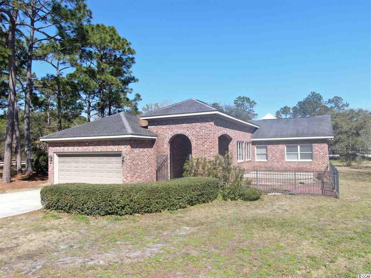 Oozing with character, this rare find in Pawleys Island boasts over an acre and a half of land boarding a private pond. As you enter through the brick arches , you will immediately notice the quality of construction and functionality you will soon call home. Upgrades / features include a private brick courtyard overlooking the water, Mexican tile and hardwood flooring throughout much of the house,  semi-custom cabinetry, and a plethora of unique architectural features. This area is arguably one of the most sought after locations in Pawleys Island and won't last long.