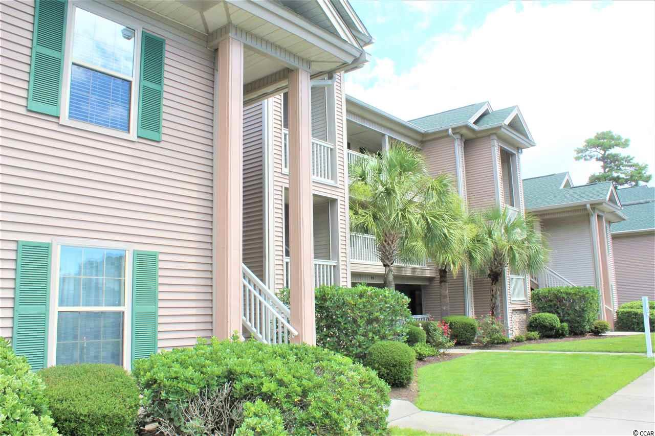Welcome to True Blue, one of the top rated  and highly sought after neighborhoods in Pawleys Island. This meticulously maintained and tastefully furnished two bedroom two bath condo located on the third floor offers a stunning view of a beautiful lake and the 16th hole on par three of the legendary golf course. Spacious screened porch and extra window space allow for additional privacy and enjoyment of panoramic views in the midst of an incredibly picturesque setting.  Vaulted ceilings, authentic hardwood floors, new paint, high quality custom shade over the sliding glass door, recently replaced water heater, newer air conditioning system  with remote control thermostat make this property truly stand out among the rest. Owners have never rented and used sparsely so property is in excellent condition.  Unit sits across the street from True Blue Golf School. Come be a part of this incredible golf course community and enjoy the lifestyle in one of the most desired locations offering top quality restaurants, bakeries, cafes and boutiques that make Pawleys Island so special and unique!