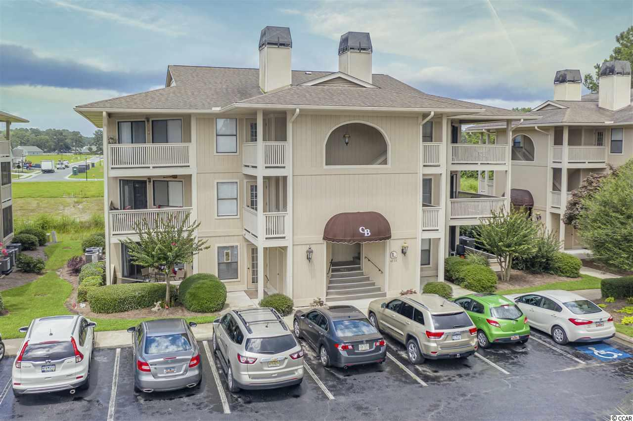 First Floor End unit Condo with great amenities that include outdoor swimming pool, hot tub, and tennis court. This 2 bedroom, 2 full bath Condo has an open floor plan, fireplace and two balconies with access from the living room and the master suite. Cypress Bay is walking distance to restaurants and shopping.  Wonderful unit that will not last long!