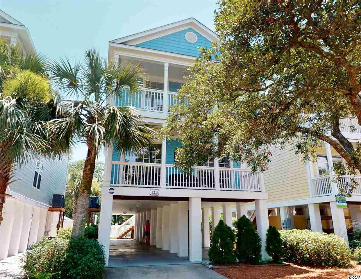 123 14th Avenue North known as Simply Irresistible is a fully furnished, five-bedroom, 4.5 bathroom, 2588 heated square foot, single-family raised beach house located 475 feet to the beach in the Town of Surfside Beach. Situated on a wide and deep R3 (zoned for vacation rentals) lot, this two-story home has a double front covered porch, ground-level storage, parking for five cars, concrete fiber siding, and low maintenance landscaping with an irrigation system. With access from the rear covered porch, the fenced-in backyard features a private heated walk-in pool with built-in seating and a large pool deck to make this yard your oasis. The home was constructed in 2004 and meticulously maintained by the owners. The open living areas with ceramic tile floors provide abundant space for large gatherings. The main level has direct access to the lower level covered porches off the living area, and there are a powder room and bedroom with an ensuite bathroom at the rear of the home. Upstairs there are four additional bedrooms, all with ensuite bathrooms, the laundry room, and a loft living area. The main master suite is located on the front of the home, has direct access to the second-floor covered porch, a private bathroom with double sinks, whirlpool tub, and separate shower. Why continue to rent when you can own a piece of one of the most beautiful stretches of the Grand Strand? Make sure to check out the Matterport 3D Virtual Tour. It's like you're walking through the home. Link to the virtual tour: www.bit.ly/12314thAveN