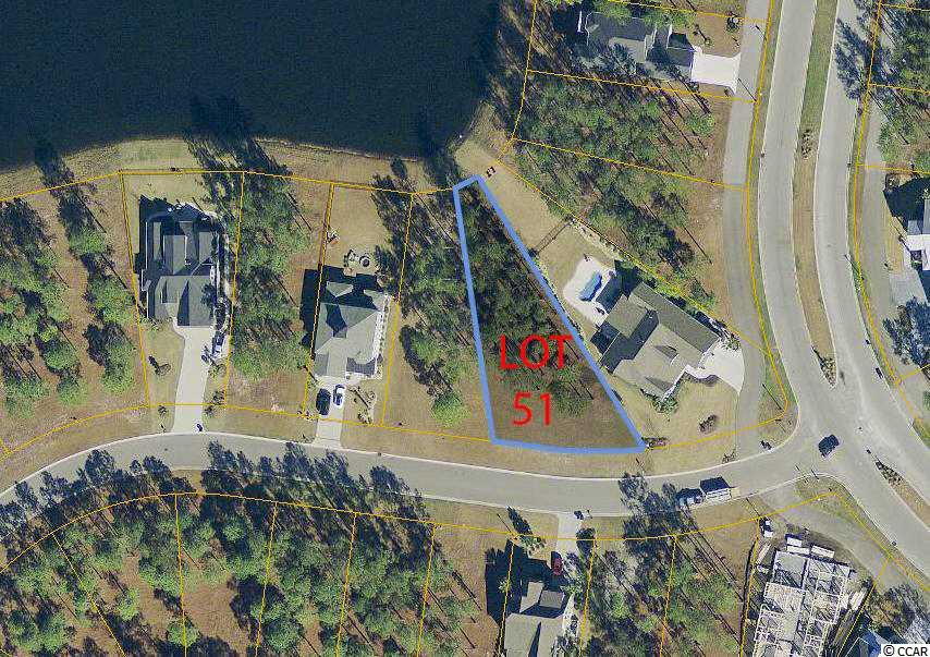 Beautiful lakefront lot with 113 feet of road frontage located in Carolina Forest in the highly sought after sub-division of Waterbridge, a gated community. No time frame in which to build and you have the option of working with one of the preferred builders or selecting your own. Amenities abound; residential pool that only can be described as amazing includes an Olympic size lap pool, swim up refreshment bar and jetted hot tubs. Just as amazing is the Clubhouse with indoor/outdoor dining and a kitchen that is caterer friendly. Other amenities include tennis, volleyball & basketball courts, boat launch and a day dock, to top things off a 24 hour fitness center. As you can see the only thing that is missing is you! Come and build your dream home here on Lot 51 and enjoy everything Waterbridge has to offer.