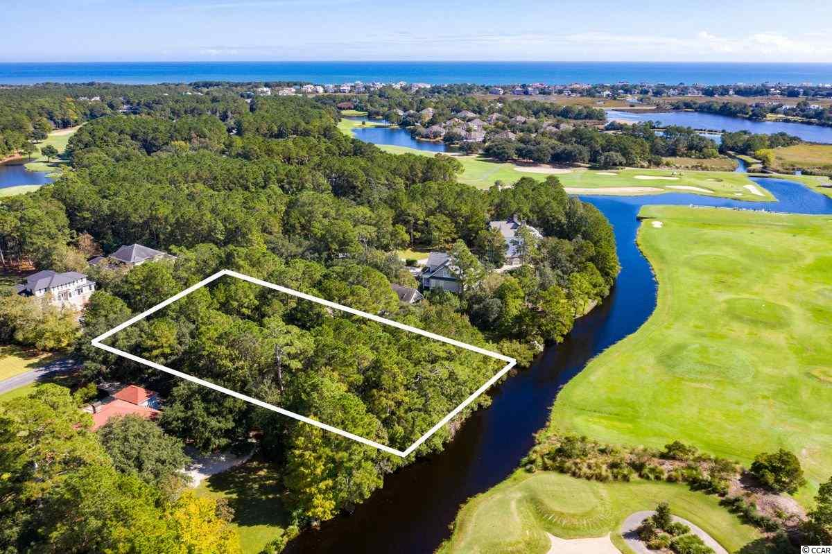 GOLF COURSE- Beautiful lakefront golf course homesite less than a mile to the beach. It has .70 acre(s) with 126 feet along the lake and 241 feet deep.