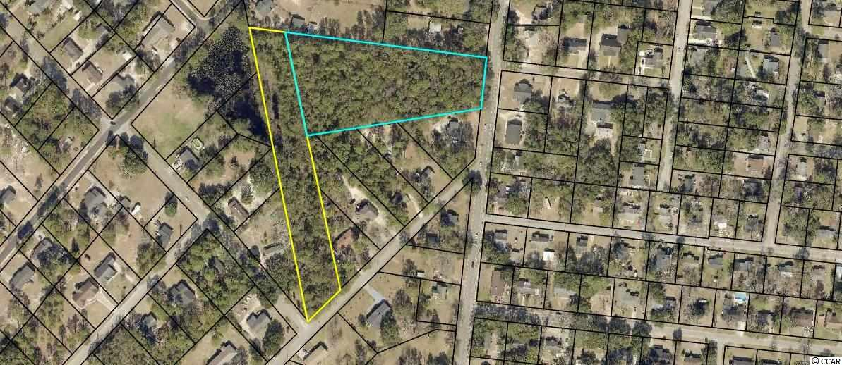 4.83 Acres in Historic Georgetown.  Build your dream home on large lot with plenty of room or the property could be developed for single family residential homes.  Lots of potential.