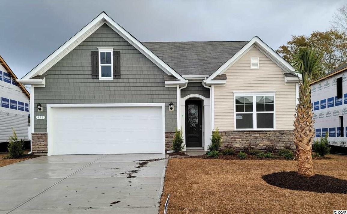 """This home is located approximately 1 mile to the beach in a golf cart friendly community! Approximately 4 miles to Market Commons and less than 6 miles to the Murrells Inlet Marsh Walk. This very popular Acadia plan features a beautiful exterior with stacked stone accents and an arched entryway. Open interior design with 9' ceilings and a great definition of space. The well appointed kitchen will include granite countertops, 36"""" white painted cabinets, and stainless Whirlpool appliances. The home also offers a rear covered porch which is great for morning coffee! The split bedroom plan creates a private owner's suite with lots of natural light, a walk-in closet, and a spacious en suite bath. This is America's Smart Home! Simplify your life with a dream home that features our industry leading smart home package allowing you to control the thermostat, front door light and lock, and video doorbell from your smartphone or with voice commands to Alexa! It's a home that adapts to your lifestyle. *Photos are of a similar Acadia home. (Home and community information, including pricing, included features, terms, availability and amenities, are subject to change prior to sale at any time without notice or obligation. Square footages are approximate. Pictures, photographs, colors, features, and sizes are for illustration purposes only and will vary from the homes as built. Equal housing opportunity builder.)"""