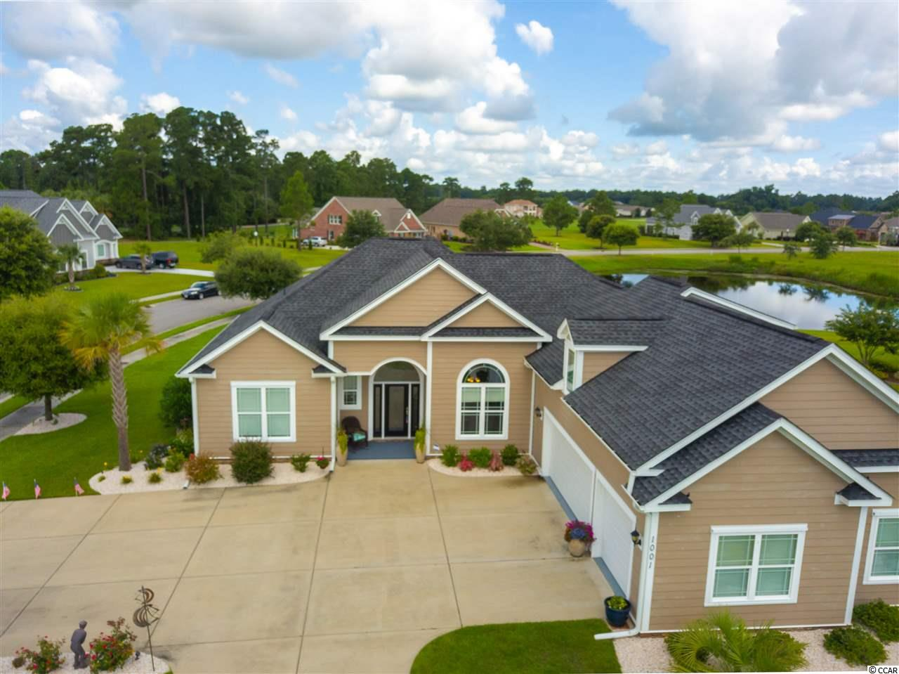 IMMACULATE, FULLY FURNISHED 4bd/3.5ba on a RARE .73 acre CORNER LOT ON THE LAKE. No one can build directly beside you and you have plenty of room for a pool! Spacious screened porch & 3-car garage - only 10 miles to the beach AND 5 miles to downtown historic Conway. Master and 2 other beds on the 1st flr and large bonus room w/ full bath over the garage- easily used as a play room, craft room, office, or 4th bed. This home boasts lots of great features including 12ft ceilings in the living areas, an eat-in kitchen w/ stainless steel appliances, irrigation system with separate meter, granite counters, lots of storage, walk-in closets, formal dining, and much more. House does not require flood insurance but wired for a generator and ready to go with easy to install hurricane shutters.  The beautiful & highly desired golf community of Wild Wing Plantation offers sidewalk streets, a beautiful clubhouse, pool, basketball court, RV/boat storage and leisurely views of the lakes and popular Hummingbird golf course.  Conway is just a short drive to everything Myrtle Beach has to offer including Coastal Grande Mall, Tanger Outlets, marinas, public docks, landings, restaurants, golf courses, shops, entertainment, Myrtle Beach International Airport, Broadway At The Beach, The Market Common, Barefoot Resort and Coastal Carolina University (CCU). Also, only 90 miles to beautiful Charleston, SC!