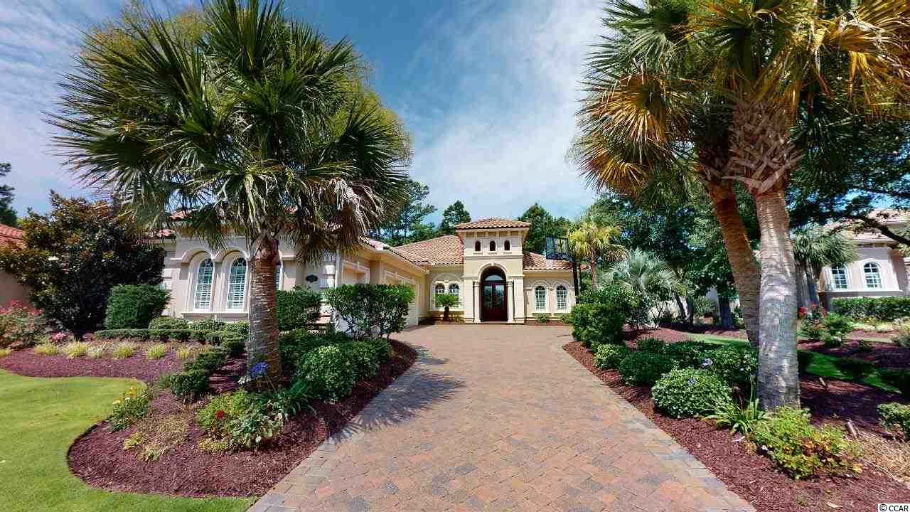 """Completely updated Hurricane fortified ICF home on over 1/2 acre treed lot that backs to Grande Dunes Resort Golf Course. Meticulously (newly) landscaped yard with emerald zoygia grass, Victorian flower beds, irrigation system along with new landscape lighting around entire property. Chefs kitchen includes gas stove with griddle, wine fridge and built-in icemaker, extensive above and below cabinet lighting. Great room has beautiful built-in cabinetry that holds 75"""" tv along with a cozy gas fireplace. Textured walls and decorative niches through out. Huge 2nd bedroom with sliding doors that walk out to screened Lanai. New HVAC and new extended grilling patio and lounging area. 3 car garage has new custom poly aspartic flooring (cabinets do not convey), driveway has been expanded for ease of parking in and out of garage.    HOA dues include Grande Dunes Ocean Club amenities, poolside resort style food and beverage service, fine dining, private beach parking and beach chair/umbrella set up daily. There are miles of biking/walking trails.   Grande Dunes has two 18 hole championship golf courses featuring public play at Resort course and opportunity to join the Members Club which is the only private Country Club in Myrtle Beach, sports membership includes Har-tru tennis and work out facility. Note there are many restaurants with in Grande Dunes proper and a deep water marina for your boating needs. Square footage is approximate and not guaranteed. Buyers responsible for verification."""