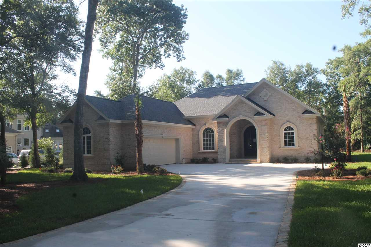 This To Be Built is located on a quiet cul-de-sac in the Vintage section of The Reserve, a collection 52 estate sized lots.  This .52 acre home site backs up to the Par 3, 12th hole of the private Greg Norman golf course.  A member of the McConnell Golf Group that is known for its best-in-class service, fine dining and an outstanding practice facility.  The Reserve also offers a private marina with 250 boat slips, including 40 wet slips, fuel and immediate access to the Intracoastal Waterway. Situated in a well-protected deep-water cove, the marina offers upscale amenities. Memberships are available for both Golf & Clubhouse and the Reserve Marina.  Enjoy Private Beach Access through Litchfield By The Sea that offers a large oceanfront deck, clubhouse, private restrooms, outdoor showers, lighted tennis courts, fishing/crabbing piers and more.  Come see this beautiful property and imagine yourself living the life of luxury.