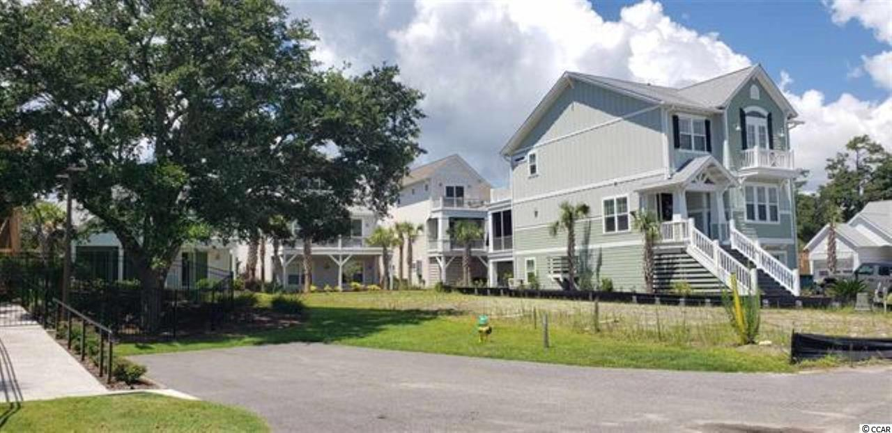 """This is a rare find: This homesite is nestled within the privacy of Ocean Village located on Ocean Blvd. Just steps to the Atlantic Ocean. This gated community has soooo much personality! Live Oak Park provides a cool pool for those hot summer days and a KitchenAid grilling station for outdoor family dining. Majestic Oaks with twinkling lights that's sure to set the mood - Day or Night!  Centrally located to all your favorite shopping and dining spots. Your golf cart will have you cruising Ocean Blvd along the historic """"Golden Mile"""". Bike - anywhere -- everywhere! Amenities available include tennis and basketball courts. This homesite is located mere steps from the pool. Tropical landscaping surrounds you. Shaded Tree Hammock for relaxing!"""