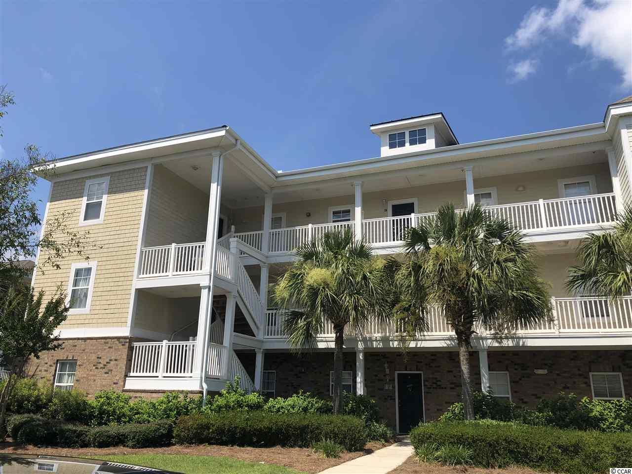 Top floor unit in Kiskadee Parke.  Balcony with pond view.  Are you looking for a unit close to Coastal Carolina or Horry Georgetown Tech?  This is it.  These are in high demand for student rentals and other local renters.  Located 10 miles to the beach.  Golfers.  Are you looking for a getaway at the beach?  This is located close to Wild Wing Plantation.  The refrigerator, washer and dryer are included.  Vaulted ceilings.  The property is rented on a month to month lease. The current tenant would be willing to stay and lease back. if you are buying for investment.