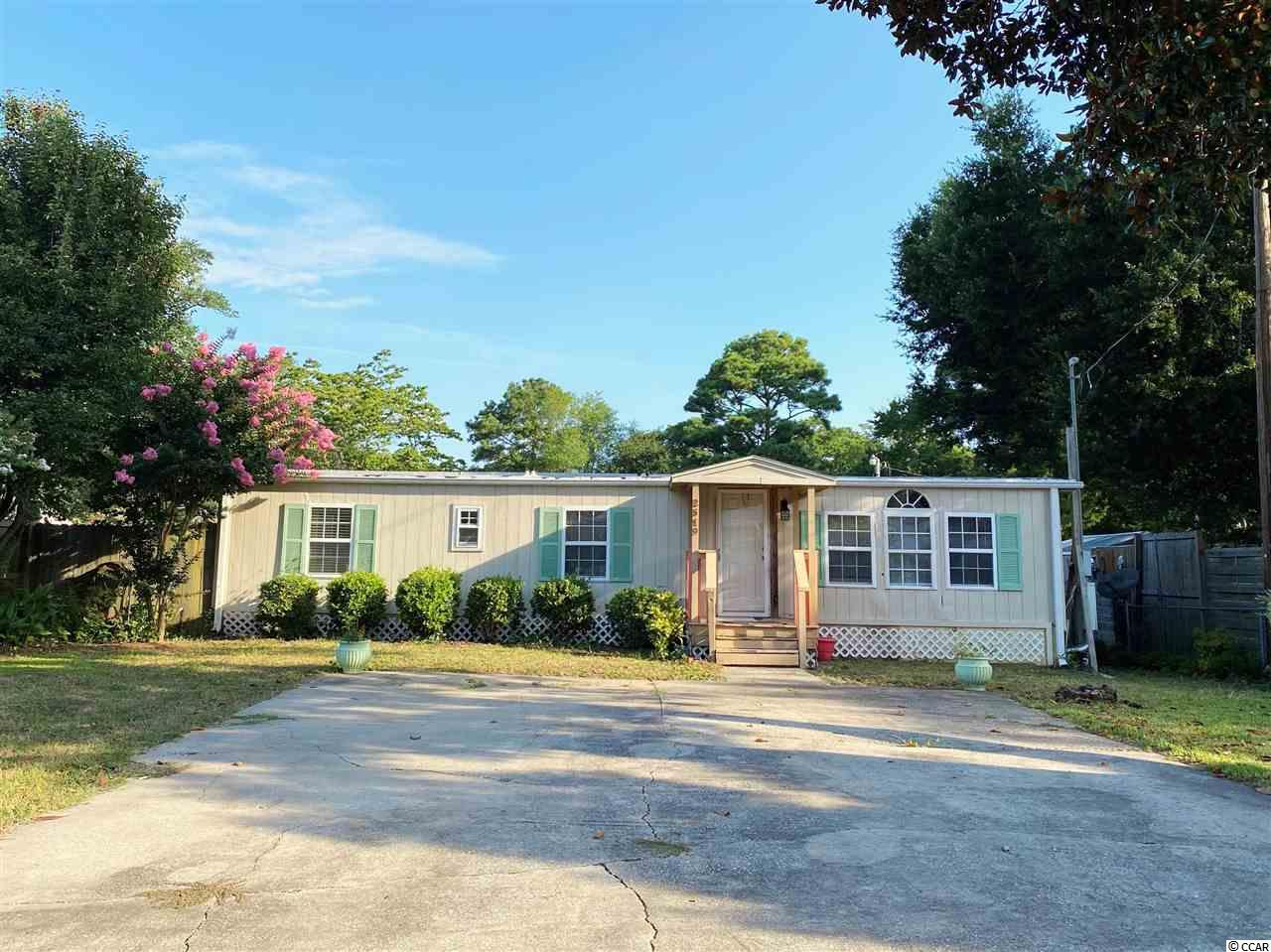 HANDY MAN SPECIAL!!! This property is being sold as is where is condition. This lot is a two sided street located in The Grove. This is a 1974 double wide manufactured home. Two sheds on the property for plenty of storage. Just an estimate of 5 minutes from the beach! NO HOA'S!!! This home is located near all shops, restaurants, golf, and entertainment North Myrtle Beach, SC has to offer. Buyer is responsible for all measurement verification.
