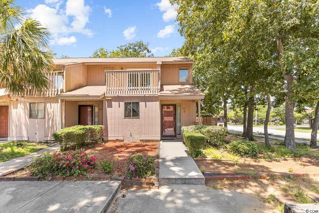 """Here is your chance to have your own townhome at Hurl Rock Village.   This End Unit Townhome is spacious and approx 400 yards from the beach and walking distance to restaurants and stores, just minutes to the airport.    Enjoy not paying a huge monthly HOA fee- because there is NOT one.   Covered front porch and tiled entry area is convenient for the """"beach life"""".  The spacious dining and kitchen area,  new hardwood steps, a laundry closet, half bath and large living area all on the first level.   Just off the living area outside is a private fenced rear courtyard offering a storage closet and a perfect space for grilling and dining alfresco.   Upstairs your will find a full bath, and 2 large bedrooms each with double closets and each have new sliders leading to balconies that have just been renewed.   Water heater was just updated in 2019.   Whether you are looking for a residence, vacation getaway, or rental investment, this home will not disappoint."""