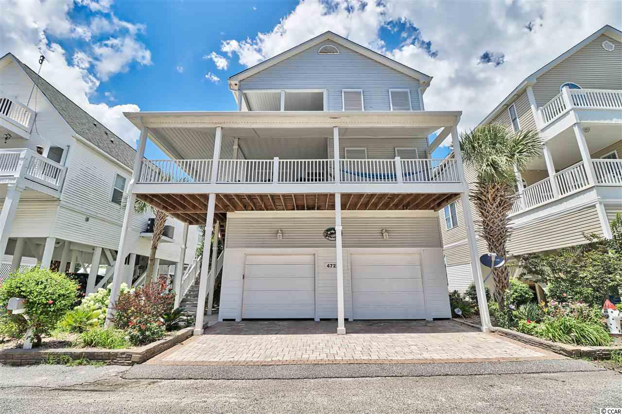 Stunning Marsh Front residence on creek with Ocean views from front porches. Notable interior features include: custom tile work, granite countertops, under-mount sinks, new light fixtures, new plumbing fixtures, double oven in kitchen. Notable exterior features include: irrigation system, landscape plan, fully functional Bahama shutters, automatic roll down hurricane shutters, garage doors, covered parking for five automobiles, and a putting green (could be converted into a pool). Dock with steps into creek for kayaking and fishing. No expense has been spared. Breathtaking, view of the salt marsh from back rooms and porches, and ocean views from front porches. Elevator with automatic gate goes to each floor and has windows with a marsh view. Easy walk to restaurants, Barefoot Landing, and steps from the beach. A must-see home unlike any in the area.