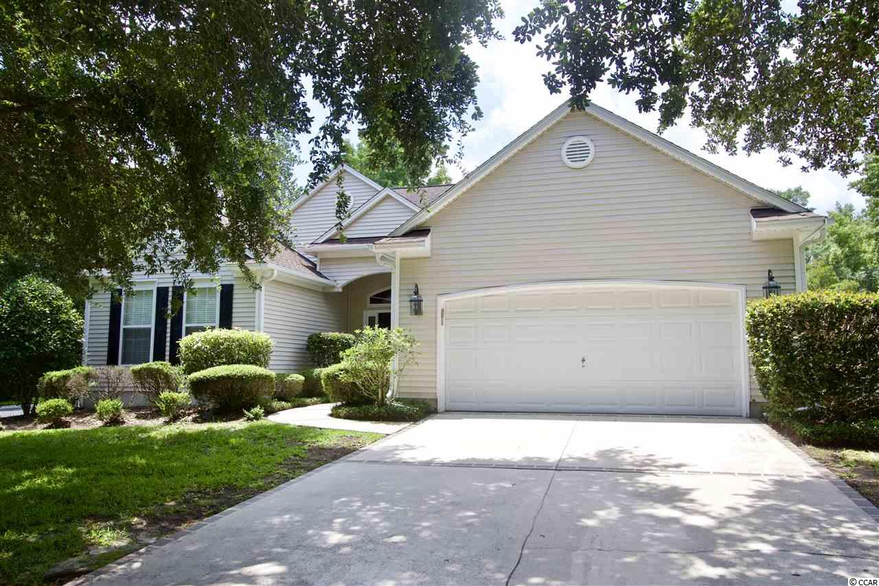This spacious 3 bedroom (plus an office and a Carolina room) 2 bathroom home is located in the highly sought-after golf community called The Tradition. This home has many upgrades including: extra storage, hardwood flooring, built-in book shelves, new carpeting in bedrooms, gas fireplace, high ceilings, carolina room, office, formal dining room, fenced in yard, custom closets, custom built-in cabinets in the garage and so much more! The garden area is the star of the home with your own private pool on the property. The carolina room over looks the pool and has dual access from the master and the office. Outside there are two large awnings for shade and tons of space for seating, grilling or having a fire. You will have access to numerous amenities such as a large community pool and an owners clubhouse (with kitchen), 2 tennis courts sidewalks and an award-winning renowned golf course (optional membership to Tradition Golf Club). You will also have access to the gated and secure Litchfield by the Sea community amenities - a golf cart ride away and you too can enjoy private beach access with owners' clubhouse, showers, bathrooms, and plenty of seating. The total HOA monthly fee currently being paid includes all of the optional amenities this community has to offer. If you're not interested in the Litchfield By The Sea Access you can lower your monthly HOA fee. The home is nestled between Charleston and Myrtle Beach--close to Brookgreen Gardens, Huntington State Park and you'll have access to 9 golf courses in Pawleys Island. Interested in boating or fishing? You're only a golf cart ride away from the local marina with dry stack storage and deep water access. You're only 2 miles to the salt water creeks full of flounder, trout and red fish. This can be your primary residence or vacation home with all of the perks of resort-style living!