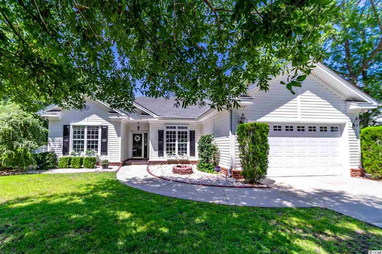 "Located in the popular Litchfield Country Club, this immaculate home is situated on a well manicured lot, shaded by mature hardwoods and a golf cart ride away from the relaxing South Litchfield Beach.  As you enter the front door, you will be amazed by the spacious feel of this beautiful home. The open feel creates a relaxing floor plan that flows from the living room, to the kitchen and dining area that extends the length of the home.  Throughout the home are maple harwood floors, 9"" ceilings and crown molding.  The kitchen has additional bar seating with granite counter tops, 42""cherry cabinets and a spacious pantry. The dining area has a large picture window allowing for guests to enjoy the outdoors while dining.  Perfect for young families, this home has a split bedroom plan with the two bedrooms sharing a bathroom and the master bedroom suite is located on the opposite side of this adorable home.  The master bedroom is spacious and inviting. Features in the master bath include a double vanity, garden tub and stand up shower updated within the last year. The retractable windows in the Carolina room allow for extended living space, with its own heated and cooling unit.  Large and open back yard with plenty of space for a pool. Double car garage with additional storage and attic space. Centrally located in beautiful Pawleys Island, SC.  Less than two miles away from the beach, 20 miles south of the Myrtle Beach area and 70 miles north of Charleston, SC."