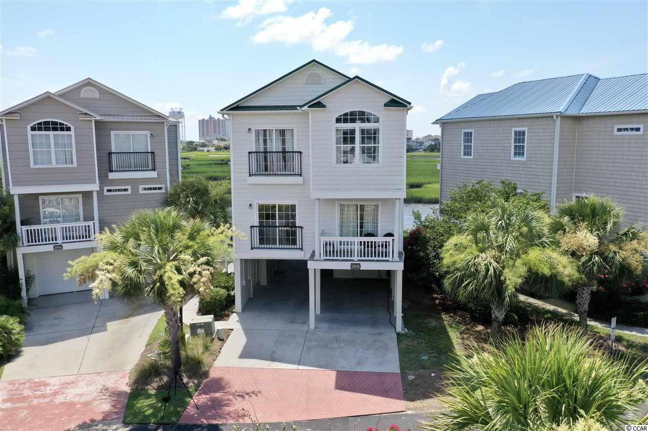 Here's One Of those North Myrtle Rarities Everyone Is Seeking!  5 Bedrooms 4 Baths Private Swimming Pool and Elevator - 2 Story Raised With Absolutely Gorgeous View Overlooking The Marsh In Cherry Grove - What More Could You Ask For!  Sold Completely Furnished, Real Hardwood Floors. and EXCELLENT Rental Income Potential - Bonzai!  If You're Looking For A Home That Has It All - Here It Is!  Only A 5 Minute Golf Cart Ride Down To The Beach, This Immaculately Maintained Has Been Kept Near Perfect By It's Original Owner.  Loaded With Features Including Balconies On both Floors Including The Master Bedroom, Enclosed Ground-Floor Storage, Outdoor Dining Area, Irrigation System, and Much More You'll Have To see For Yourself!