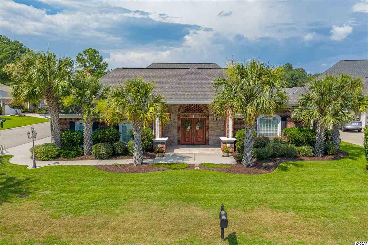 If you are looking for the perfect private oasis to use as a primary or second home residence, this is it! This custom, all brick home is exclusively unique to the gated Waterfall community. It features a spacious mother in-law suite with a walk-in closet, it's own bathroom with private access to your own pool and hot tub. You will be impressed with the condition of this home! It is like new. The main house features three bedrooms, two bathrooms, beautiful well kept hardwood floors throughout the main living area, a fireplace, high ceilings, a massive kitchen and master suite. The kitchen features an oversized island & refrigerator, walk-in pantry, all stainless steel appliances, granite countertops and plenty of cabinet space. This home has a warm and comfortable ambiance due to its open floor plan, natural lighting, and high windows. The master bedroom features a sitting area and walk-in closet of your dreams. The master bathroom is a world of its own! Double vanities with granite countertop throughout, plenty of storage space in the linen closet, and a gorgeous extra large tiled shower with a tub. Did I mentioned the extended side load garage? Plenty of parking space for four cars outside and two cars inside with additional room for storage. This property is located 8 minutes from the beach, shopping and dining. It is also 4 minutes from the Carolina Bays Parkway (SC31) and from the North Myrtle Beach Park & Sports Complex where you can enjoy a diverse selection of sporting events and wide variety of amenities such as walking/biking trails, 3 acre dog park, 7 picnic shelters, and 25 acre lake for water-related activities to name a few. The Waterfall community sits on a 8.5 acre stocked up lake where you can enjoy fishing and community pool, gym and more! You do not want to miss this beautiful home. Schedule your showing today!